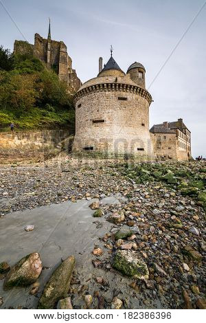 Side part of Mont Saint-Michel viewed from the low-tide bay coast, Normandy, France