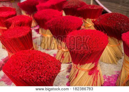 Red incense sticks, process of painting. Dalat Vietnam