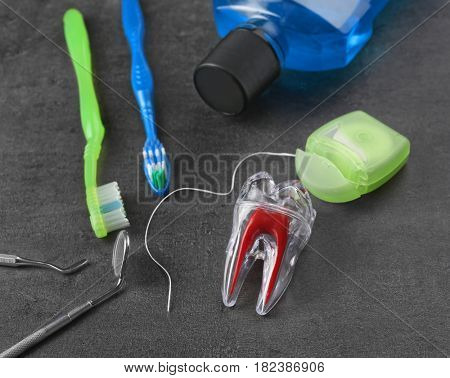 Dental instruments and set for teeth cleaning on grey background