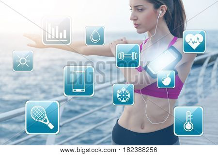 Sport application concept. Young woman training with smartphone outdoor