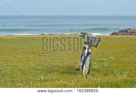 Bicycle on the background of the Atlantic Ocean