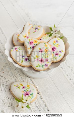 Colorful Easter biscuits. Floral icing decorated cookies.