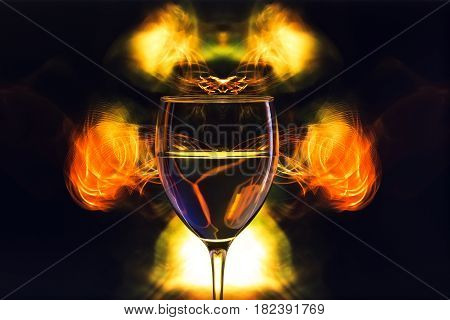 glass filled with liquid on a bright abstract fractal background