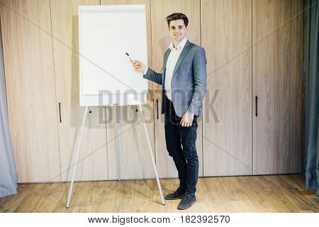 Successful Business Man With A Flip Chart In A Presentation In Modern Office