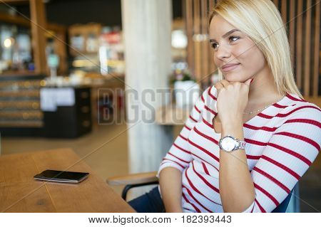 Beautiful woman resting in cafe gossiping and talking with friends