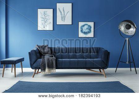 Fancy grey lamp in blue spacious trendy living room
