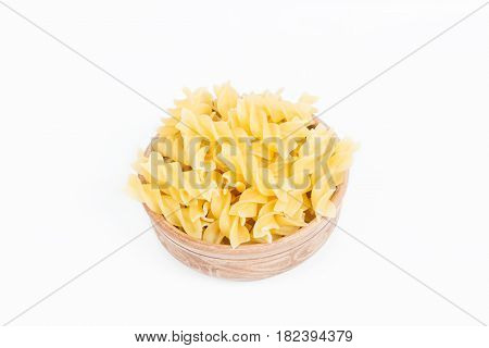 Raw pasta in a dish isolated on white background