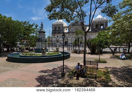 Leon Nicaragua - April 13 2014: People at the Parque Central with the Cathedral of Leon (Our Lady of Grace Cathedral) on the background in Nicaragua Central America