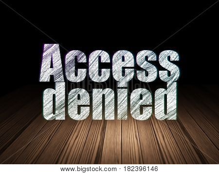 Privacy concept: Glowing text Access Denied in grunge dark room with Wooden Floor, black background
