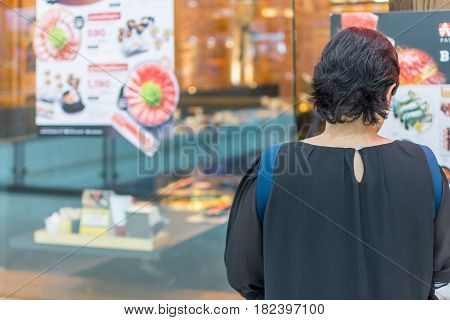 Asia Women Stand At Front Of Barbecue Restaurant