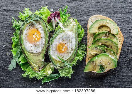 Avocado sandwich and Chicken egg baked in avocado. Delicious meals.