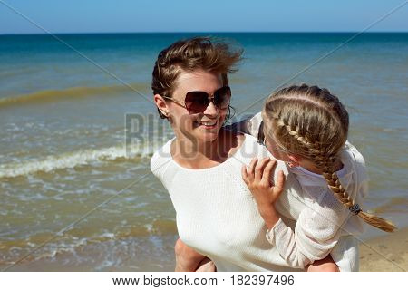 Parent and child happily spend time together. The concept of summer family vacation