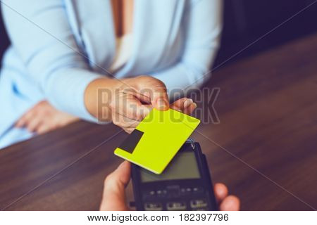 Woman Using Payment Terminal Paying With Credit Card, Toned
