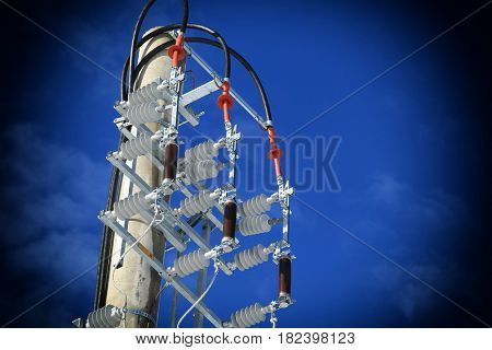switches in air of a high voltage power line with concrete pole and electrical insulators