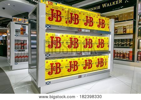 Saint Martin Dutch Antilles March 28 2017: J & B whiskey bottles stand for sale in a airport duty free store.