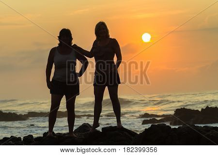 Women Silhoueted Sunrise Ocean