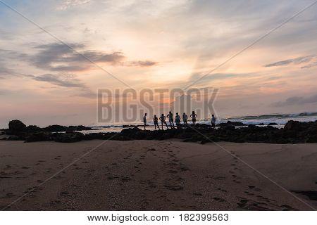 Girls Boys Silhoueted Sunrise Ocean