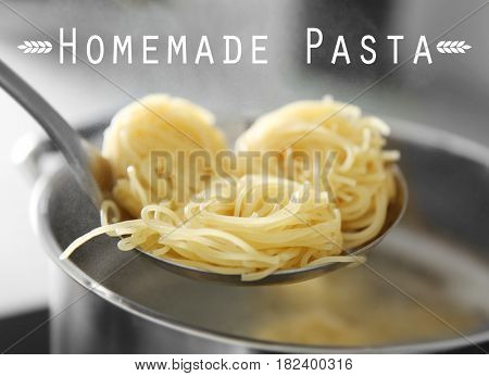 Homemade pasta in skimmer over pan, closeup