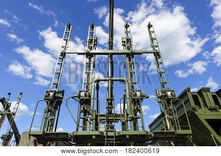 Military piling machine for bridge construction, army engineering special-purpose equipment, heavy industry, white clouds and blue sky on background