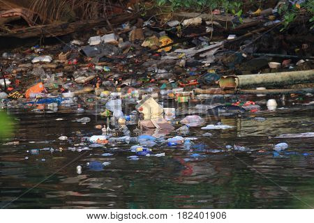 KHAO LAK, THAILAND - 15 APRIL 2017: Plastic bottles and bags pollution in ocean. Environmental damage due to lack of recycling.