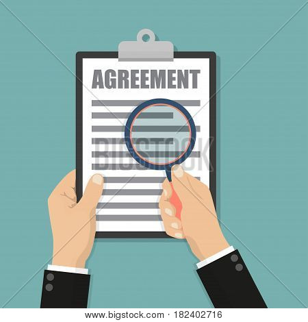 Businessman holding magnifying glass and clipboard with agreement