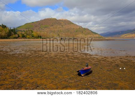 Inveraray Argyll and Bute Scotland UK Scottish town view across Loch Fyne with boat