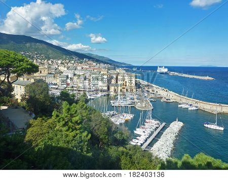 Bastia Corsica view down to the old port modern port with ferry in the background