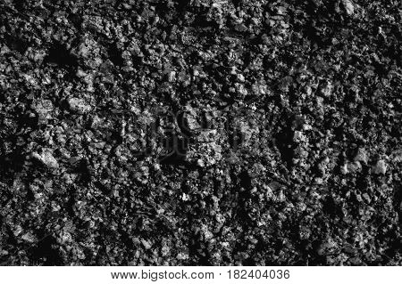 Abstract grey texture. Stone and rock background. Natural texture. Black and grey abstract texture and background for designers. Natural stone pattern. Macro and closeup view of grey stone.