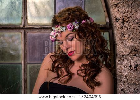 Beatiful dreams / A young girl with a wreath on her head
