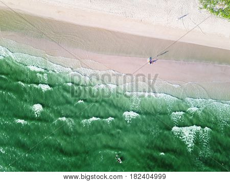 Sandy Beach And Greenish Sea