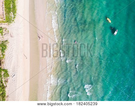 Sandy Beach And Greenish Sea