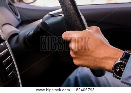 a business man control and sit in car