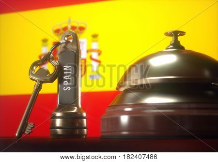 3D illustration. Luxury hotel key and vintage golden bell of the Spain on the wooden table of the lobby service.