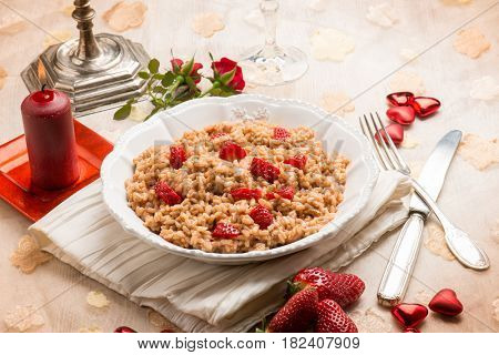 risotto with strawberries over luxury table