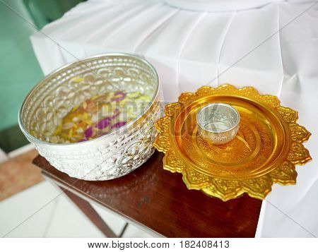 Aluminum bowls and golden plate for use in Songkran aka Thai New Year's festival in Thailand