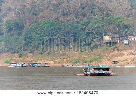 Luang Prabang, Laos - Mar 05 2015: Mekong River At Luang Prabang. A Famous Ancient City In Luang Pra