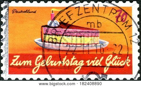 GERMANY - CIRCA 2016: A stamp printed in Germany dedicated to the birthday shows a piece of cake circa 2016