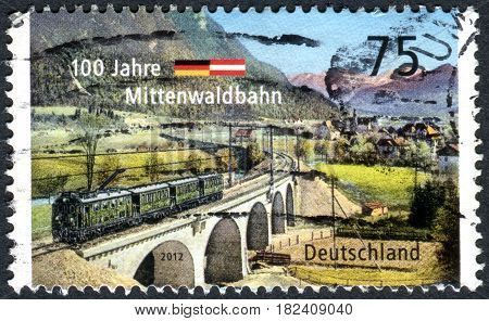 GERMANY - CIRCA 2012: A stamp printed in Germany dedicated to the 100 year Mittenwald Railway circa 2012