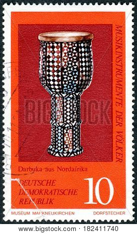 GERMANY - CIRCA 1971: A stamp printed in Germany (GDR) shows the musical instrument from North Africa Darbuka (Goblet drum) circa 1971