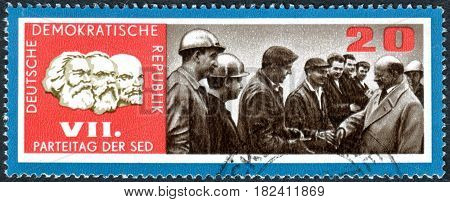 GERMANY - CIRCA 1967: A stamp printed in Germany (GDR) dedicated to 7th congress of Socialist Unity Party of Germany shows the Walter Ulbricht and factory workers circa 1967