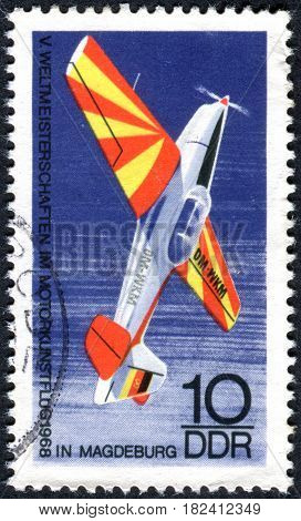 GERMANY - CIRCA 1968: A stamp printed in Germany (GDR) shows the sports airplane