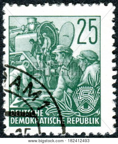 GERMANY - CIRCA 1953: A stamp printed in Germany (GDR) is dedicated to the five-year plan shows the Locomotive building circa 1953