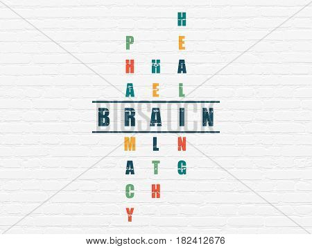 Health concept: Painted blue word Brain in solving Crossword Puzzle