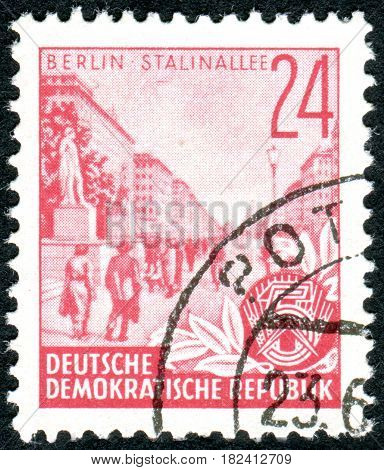 GERMANY - CIRCA 1953: A stamp printed in Germany (GDR) is dedicated to the five-year plan shows the Stalin Boulevard Berlin circa 1953