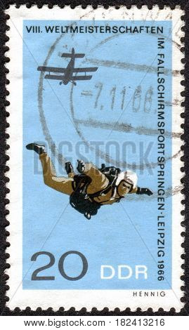 GERMANY - CIRCA 1966: A stamp printed in Germany (GDR) dedicated to 8th International Parachute Championships Leipzig shows a jumping with a parachute circa 1966