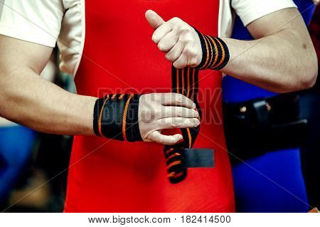 athlete powerlifter hands in wristbands competition bench press