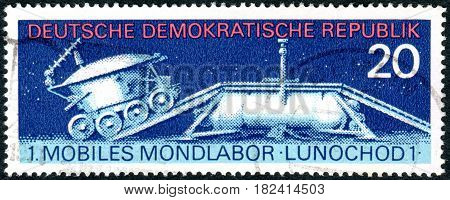 GERMANY - CIRCA 1971: A stamp printed in Germany (GDR) shows the first of two unmanned lunar rovers - Lunokhod 1 circa 1971