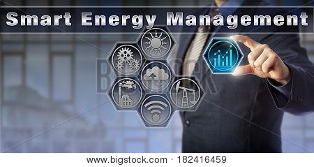 Blue chip corporate manager is remotely controlling energy and power-related information in a virtual Smart Energy Management matrix interface. Industrial technology and internet of things concept.