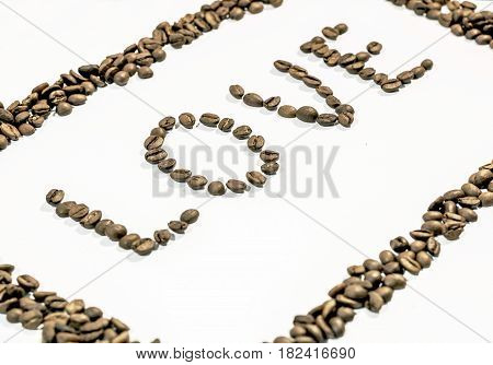 The word love written with coffee beans on white background