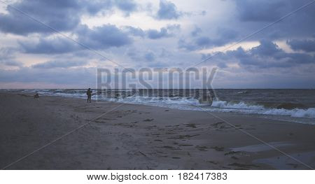 A Stormy Sea And A Man On The Shore